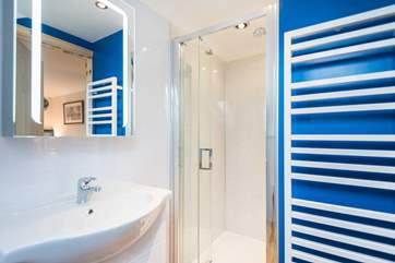 The en suite shower cubicle is larger than the standard size.