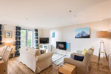 The open plan living-room is light, spacious and a super space for relaxing with friends and family.