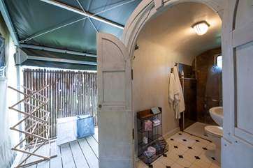 The spacious shower and toilet are behind the tent, with an overhead canopy.