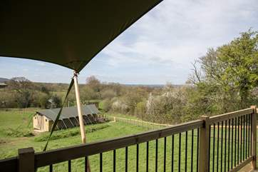 Murciano is the higher of the two luxury safari tents with fabulous views from the deck over the Blackmore Vale.