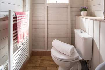 There is a flushing loo and also a heated towel rail to keep you snug.
