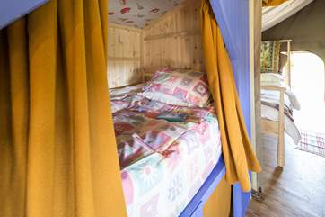 The cabin bed is a little den, where you can read by torchlight under the bedclothes and maybe even have a midnight feast!
