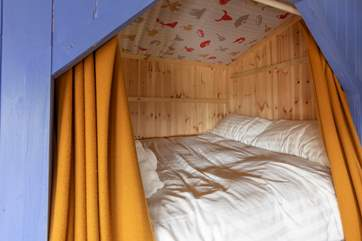 Children will love being in this cabin bed with the curtains drawn.