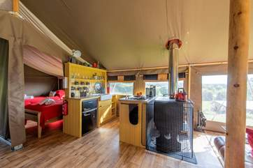 A fully fitted gorgeous kitchen-area with wood-fired range, two ring gas hob and fridge/freezer for your glamping holiday luxuries.