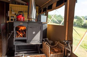 The wood-fired range is great for cooking and heating, but there is a two ring gas hob as well.