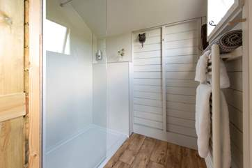 The shower-room has a glass screen and a heated towel rail for warm fluffy towels.