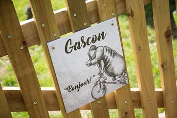 Gascon on the gate, identifies your holiday safari tent and gives a French welcome.