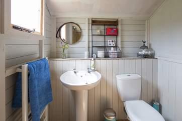 The cloakroom has a heated towel rail to keep the room snug.