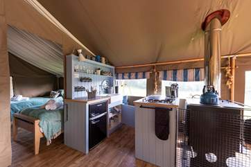The kitchen is fully equipped with a Smeg gas hob and fridge freezer for holiday goodies.