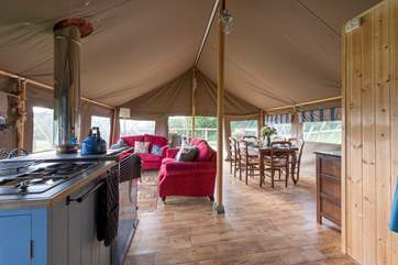 These luxury safari tents have a very spacious and sociable open plan interior.
