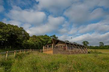 Gascon is the lower of the two safari tents, with great views over the Blackmore Vale from the decking.