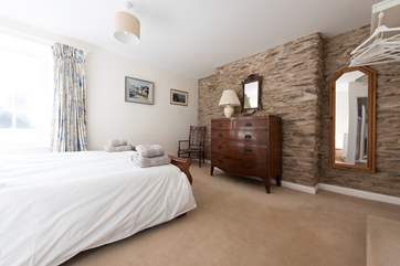 An original exposed stone wall.