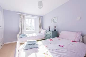 Bedroom 3 has twin beds and glimpses of the sea.