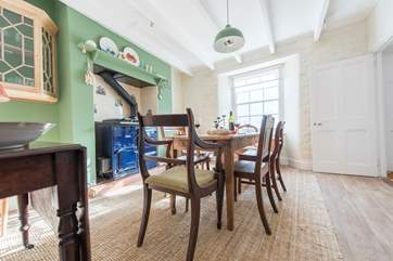Light pours into the dining-room from the large sash window.