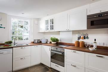 The modern kitchen is light and bright.