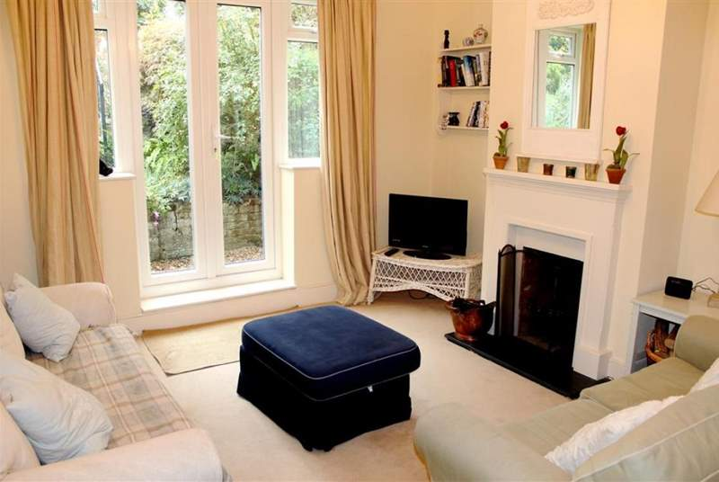Living room with doors to the pretty garden