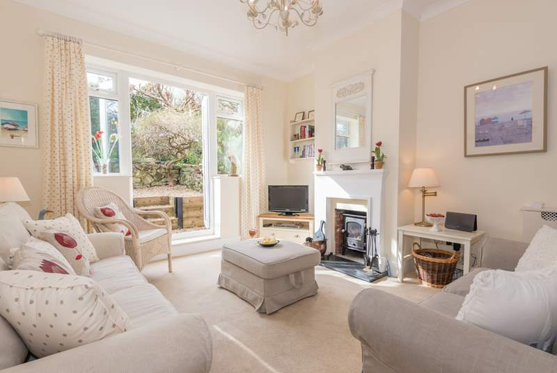 A set of patio doors from the light and cosy living-room lead out to the garden area