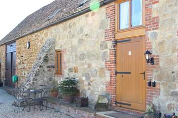 Through the large stable door you will find a door to each of the two properties in the barn.