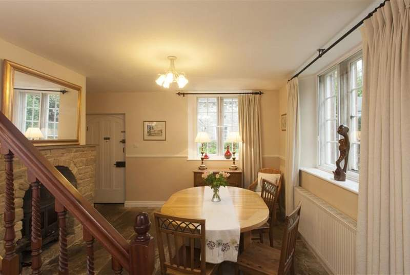 The dining-room is spacious and has a wood burner.