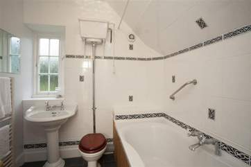 The bathroom features a mix of old and new fixtures; all the luxury of modern conveniences with an antique feel.