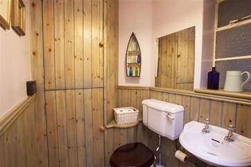The downstairs cloakroom has a nautical feel.