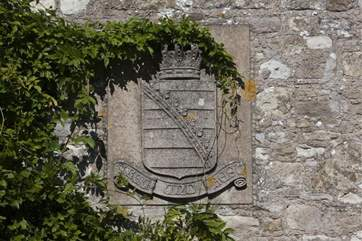 A coat of arms on the outside of the building.