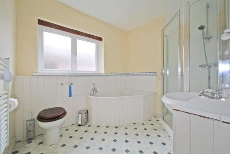 Bathroom with corner bath.