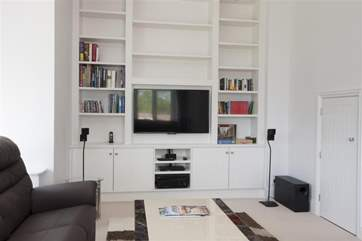 The Bose home cinema surround sound system can be found in the sitting-room, along with a Blu-ray DVD player.