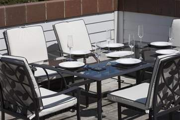 Table and chairs for roof top dining.