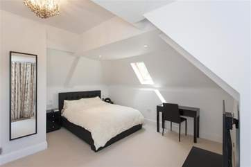 The master bedroom has its own private balcony.