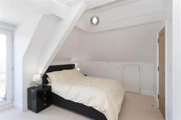 The second double bedroom also has an en suite shower room and private balcony.
