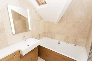 In addition to the two en-suite shower rooms there is a family bathroom.