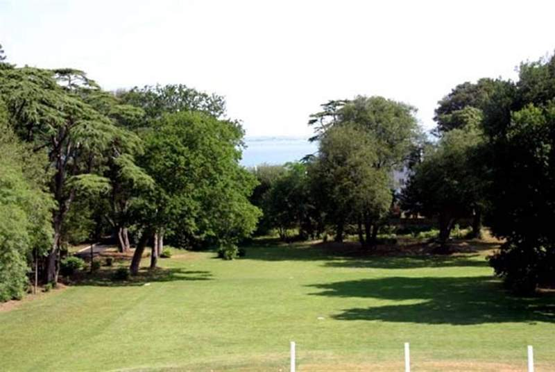 The communal grounds seen from the front of the property, with stunning sea views.