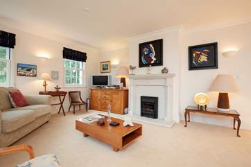 Artwork and antiques make for a beautifully appointed room.