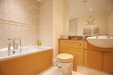 The family bathroom is modern and spacious.