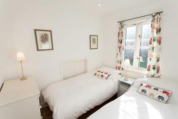 The snug twin bedroom over looking into the family garden