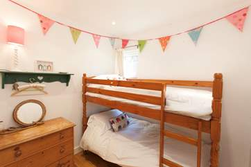 The lovely bunk bedroom, perfect for children, with night lights and bed guards provided for the smaller ones.