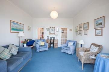 There is plenty of comfortable seating in the living room, a cosy space for relaxing with a book, where you can lift your head and see the ships go by.