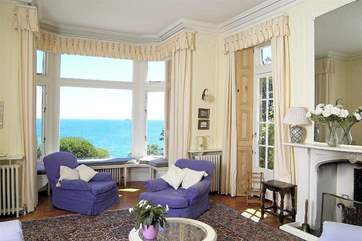 The large and spacious living room over-looking the gardens and sea beyond.