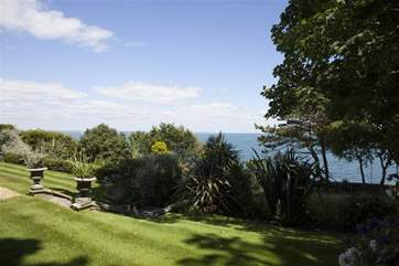 The property has extensive grounds which lead down to the beach.