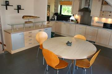 The spacious kitchen has all mod cons and seating to match.