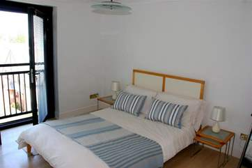 The double bedroom has a Juliet balcony providing sea views over the Solent and an en suite bathroom.
