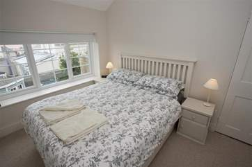 The kingsize bed which has sea views.