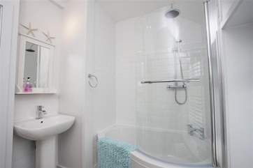 The bathroom with shower over.