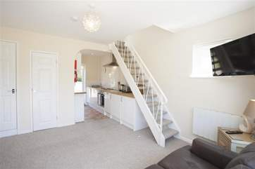 The stairs lead to the first floor, where there is a king-size bed and en suite bathroom.