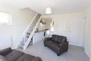 The ground floor also has a double and twin room, located off the cosy living area.