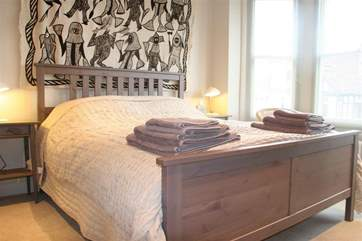 The kingsize bedroom has a comfortable feel.