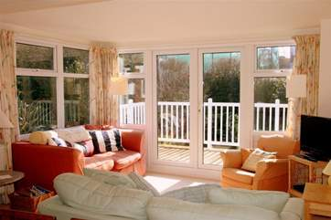 3 Astra House boasts a lovely light, sunny living room with doors out to a decked balcony