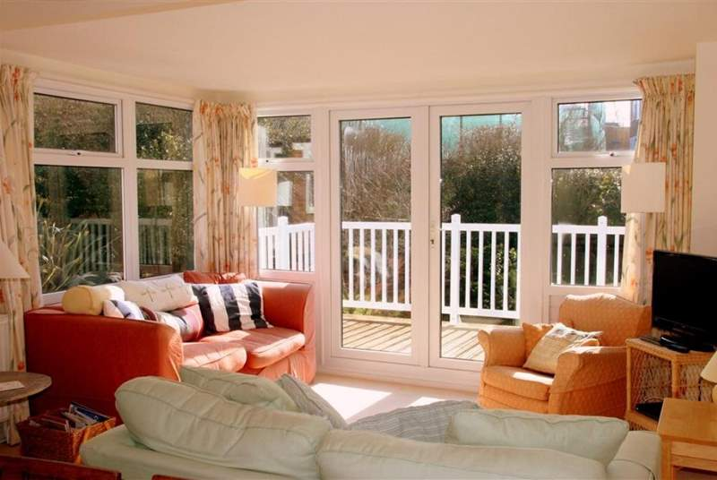 3 Astra House boasts a lovely light, sunny living room with doors out to a nice decked balcony