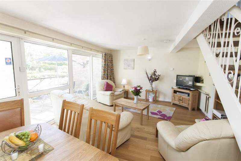 Large sunny, open plan living room and dining-area with doors out to the balcony